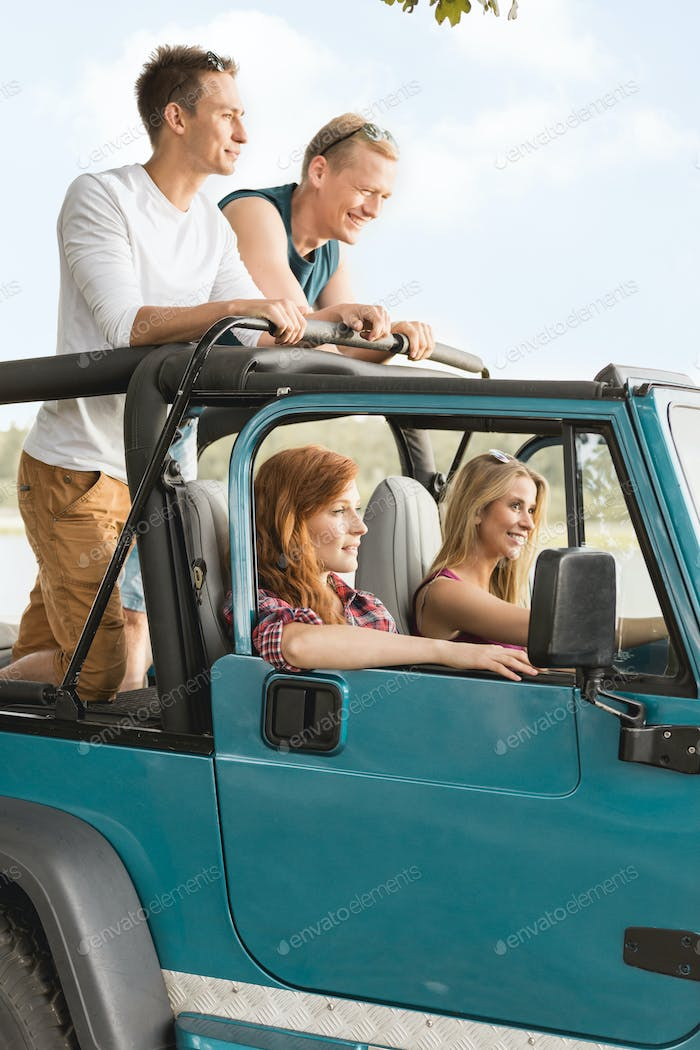 Girls driving off-road vehicle