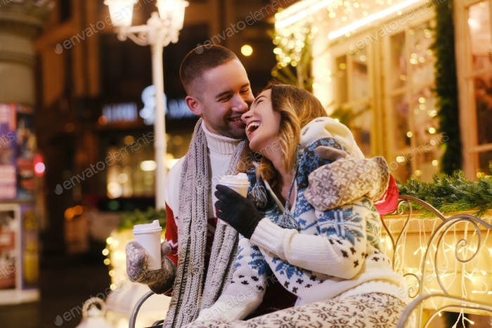 Couple of romantic people enjoy Christmas together