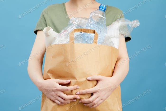 Unrecognizable Woman Holding Plastic Bottles