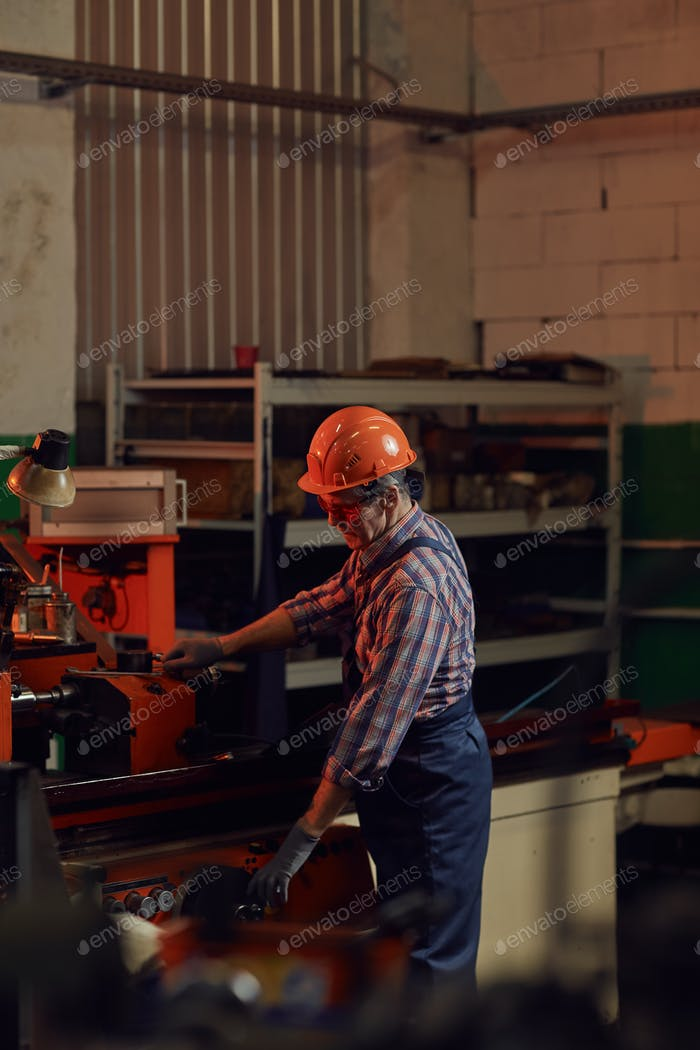 Mechanic working at the lathe