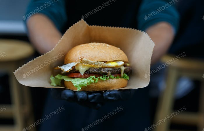 Street fast food, hamburger with bbq grilled steak