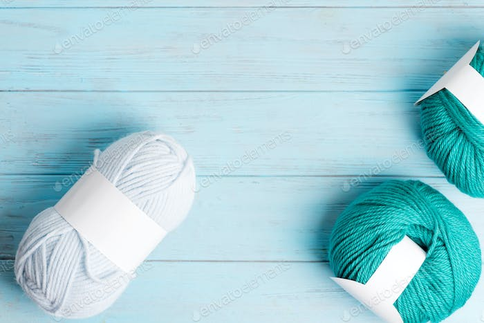 Knitting wool for creating modern cloth on a light blue background. Top view