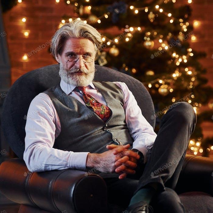 Portrait of stylish senior with grey hair and beard