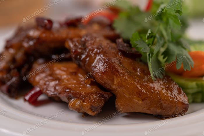 Chili Paste Fried Chicken Wings in White Platter with Chili and Coriander