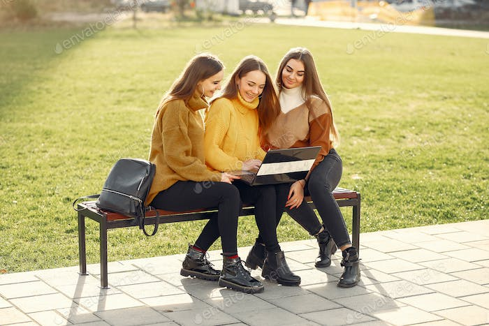 Young students sitting in a student's campus