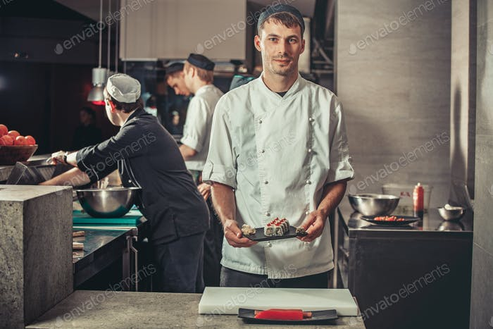 Preparing sushi set in restaurant kitchen