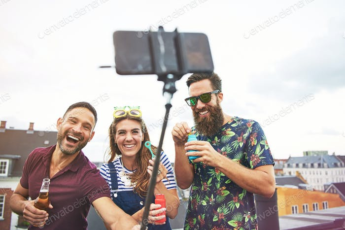Partying friends taking pictures of themselves