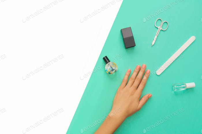 Manicured nails and tools for manicure.
