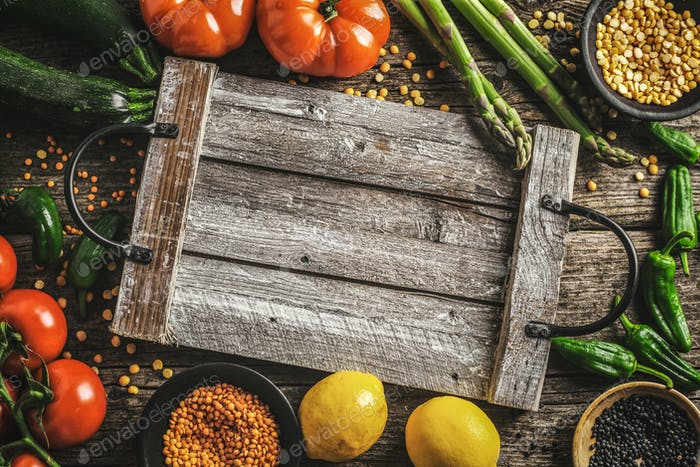 Different vegetables on wooden background