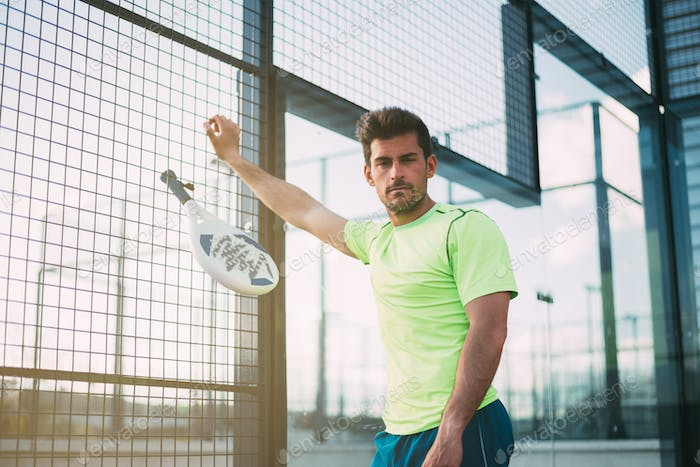Sport's man resting from playing padel