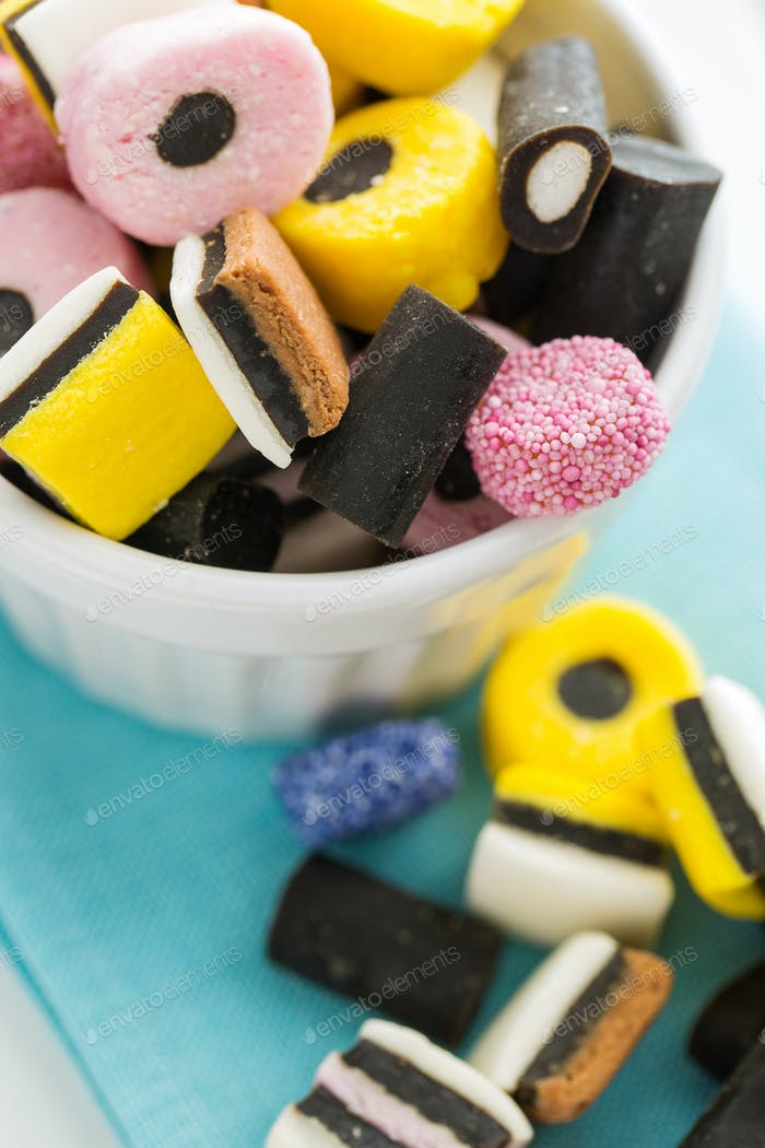 Mixed liquorice candies in bowl.