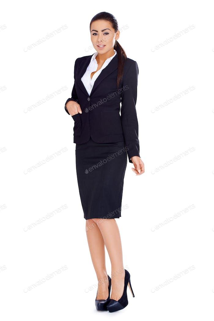 Geschäftsfrau steht über weißem Hintergrund