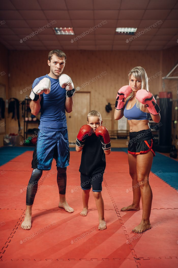 Young family in gloves on kickboxing training