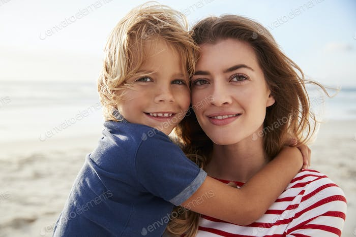 Portrait Of Mother Hugging Son On Summer Beach Vacation