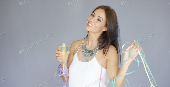 Cute merry young woman partying at New Year