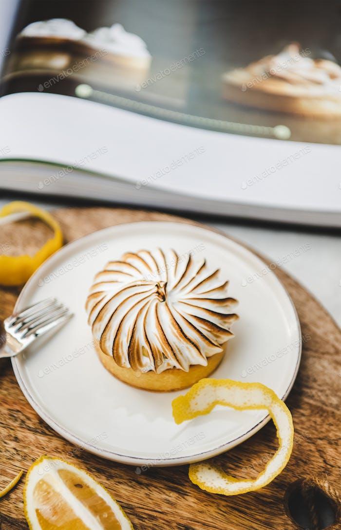 Lemon tart with merengue sweet french dessert in cafe