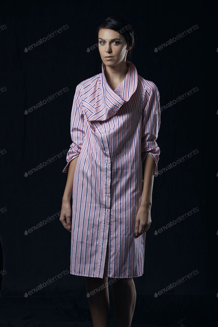 Fashion photo of young magnificent woman in pink shirt