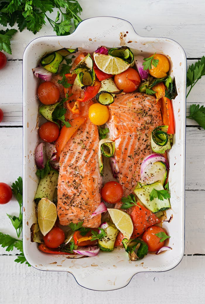 Baked salmon fillet with vegetables. Top view