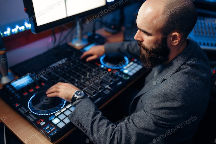 Male sound editor in the recording studio