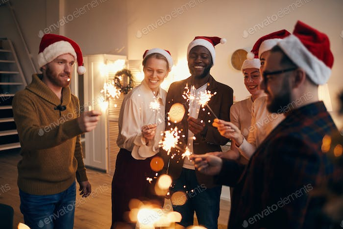 Friends Lighting Sparklers at Christmas Party