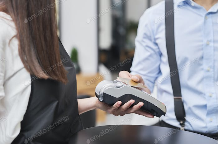 Paying by credit card in hair salon