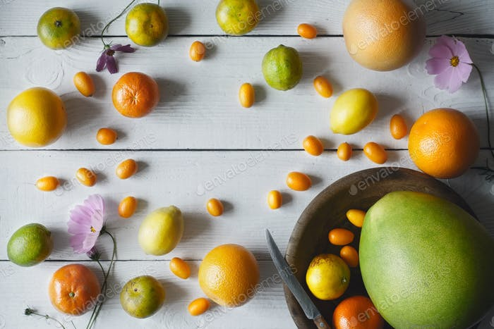 Citrus mix on the white wooden background