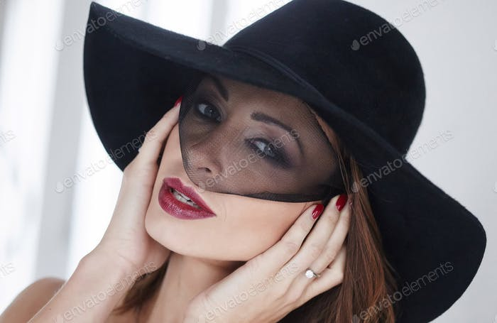 Stylish woman in a black modern hat.