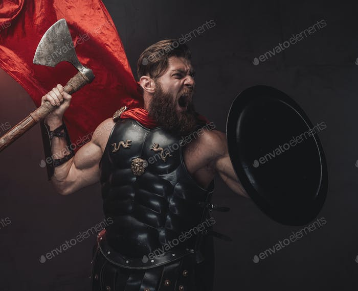 Attacking rome warrior with red mantle with axe screaming