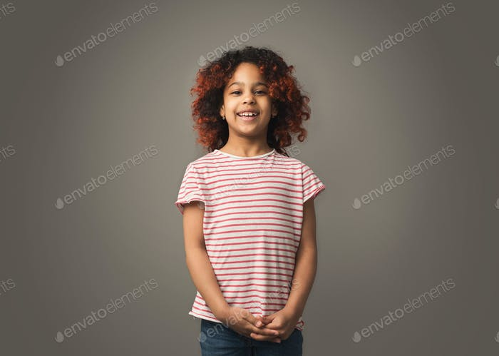 Cute black little girl at studio background