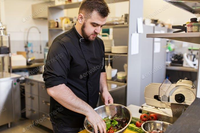 chef cook making food at restaurant kitchen