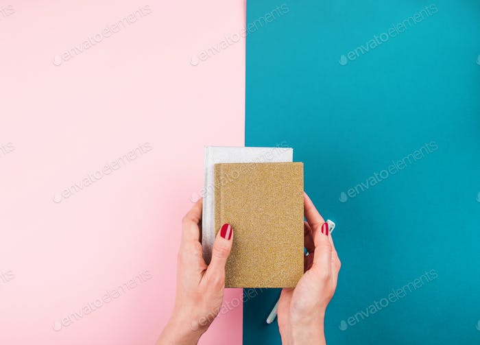 Duotone background with notebooks and pen