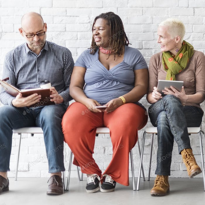 Diverse Group of People Community Togetherness Technology Sittin