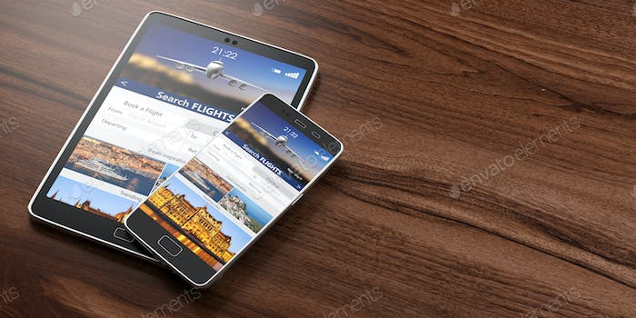 Smartphone and tablet on wooden backgound, Search flights on the screens, copy space.