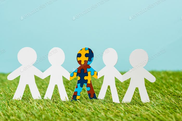 Special kid with autism among another on blue and green background