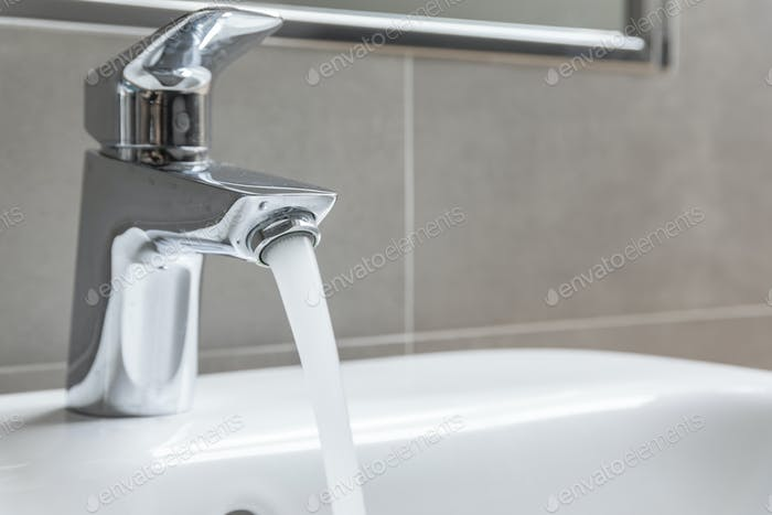 Chrome faucet with running water