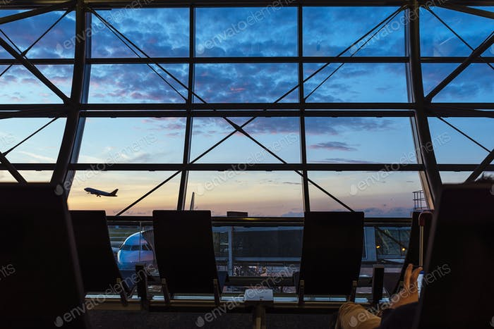 Silhouettes from inside of Airport Terminal. Aircraft Concept.