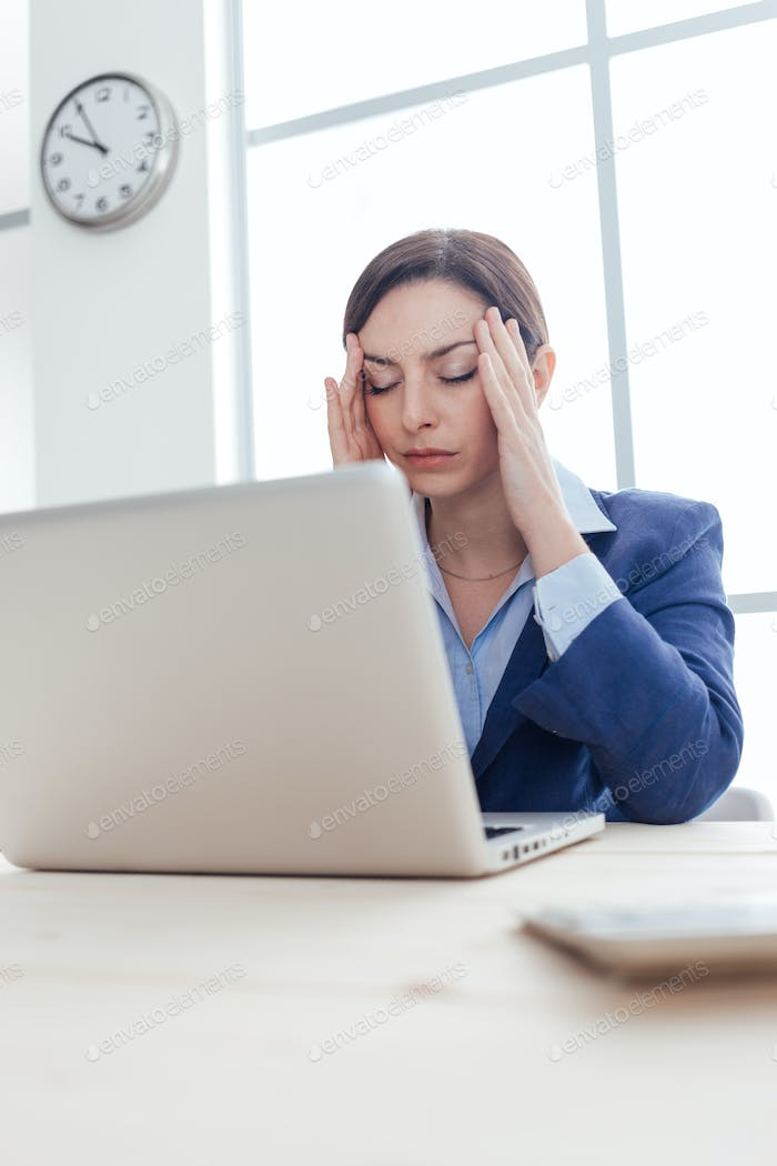 Businesswoman having an headache