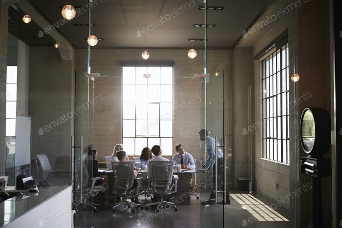 Business colleagues at a meeting in a glass walled boardroom