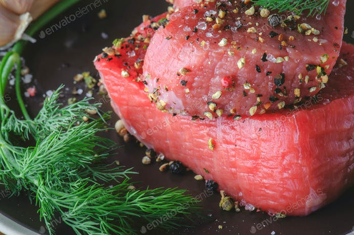 Raw Beef Steak with Fresh Spices