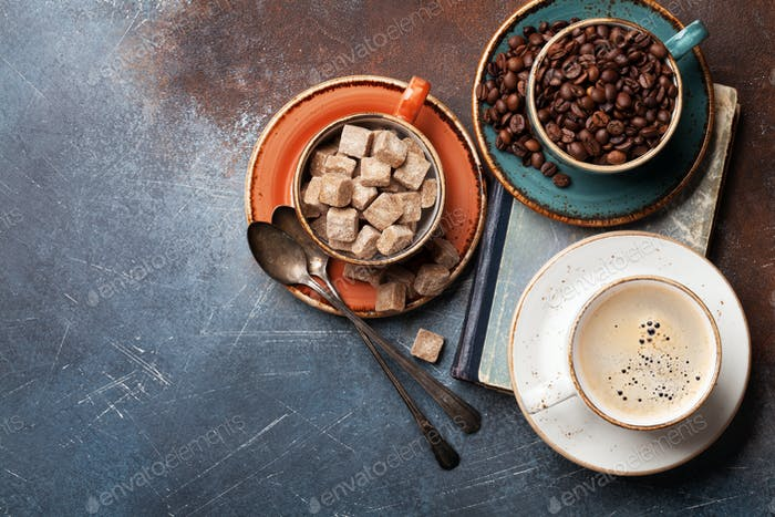 Coffee cups, beans and sugar