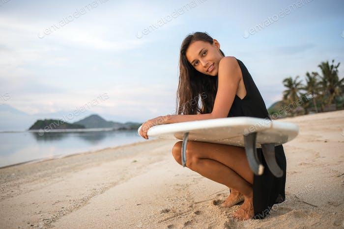 cute sporty surfer girl or smiling happy brunette woman