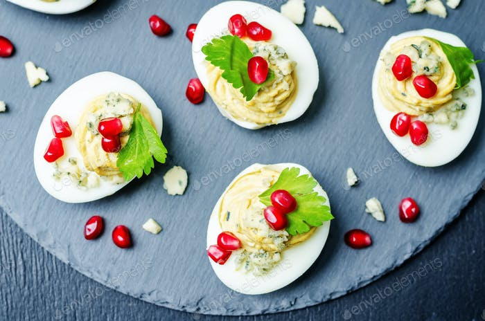 Blue cheese deviled eggs with pomegranate