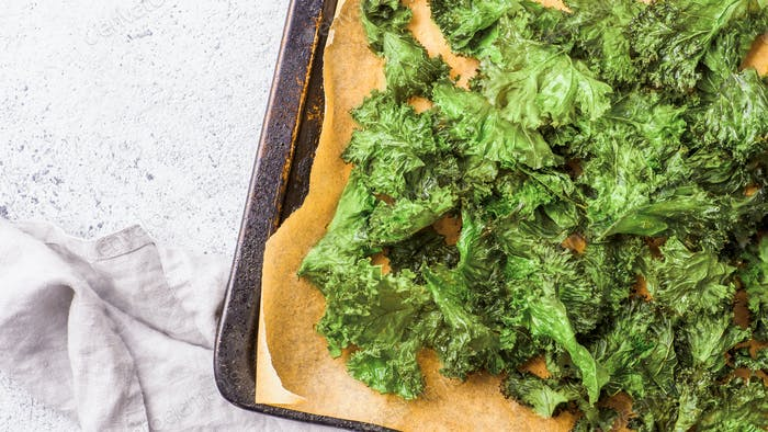 Kale Chips with salt on oven-tray, copy space
