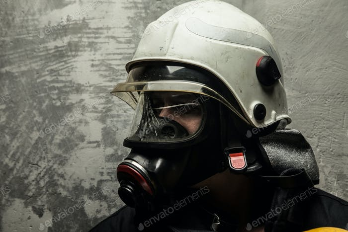 Firefighter in helmet and oxygen mask