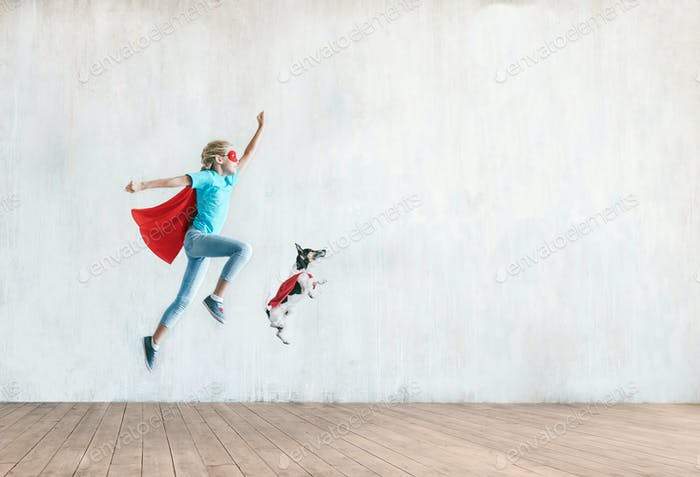Jumping little child with a dog