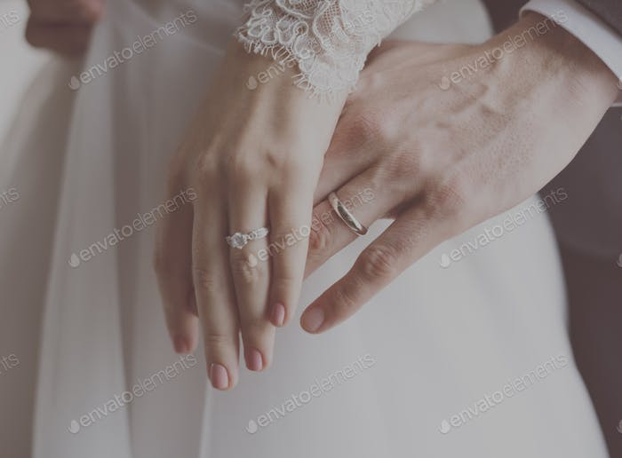 Close up of a couple with their wedding rings
