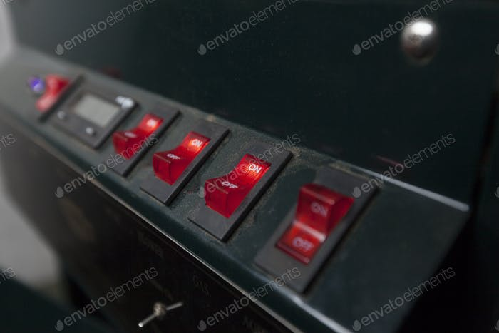 Red switches on coffee machine