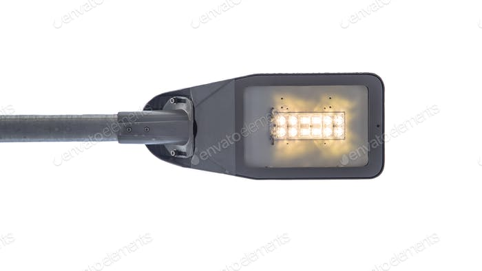 Modern LED street light on white background