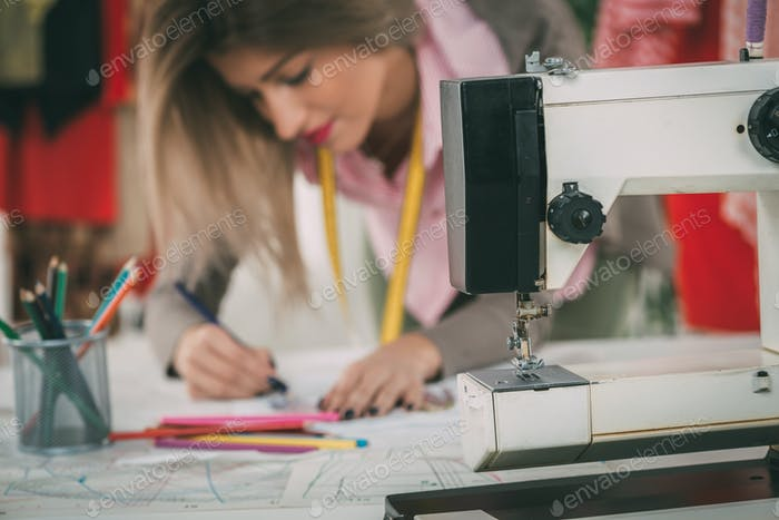 Fashion Designer With Sewing Pattern photo by micens on Envato Elements