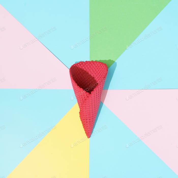 Abstract minimal background in pastel colors with red ice cream cone. Minimal summer flat lay